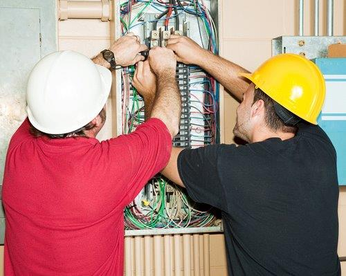 Electricians working on panel board-1