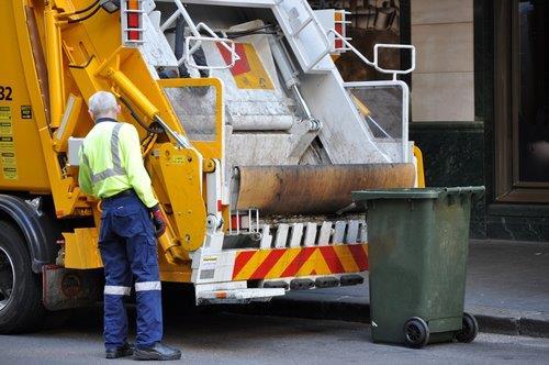 Garbage - worker picking up garbage