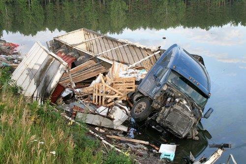 Semi Truck tip over by water